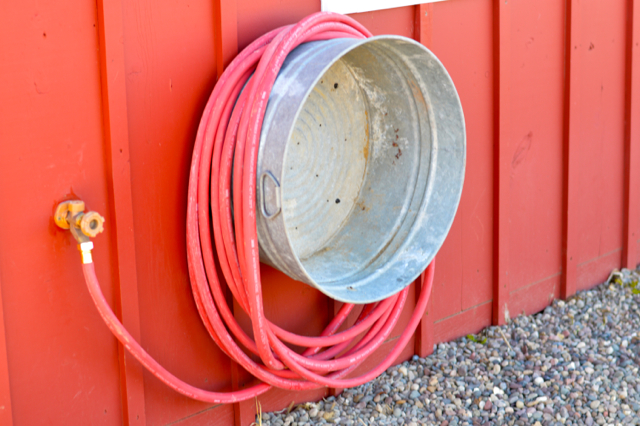 A galvanized tub can be also used to store your garden hose