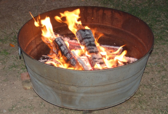 Create a fire pit from an old metal tub