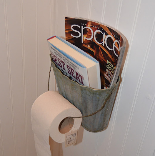 Galvanized bucket as magazine and toilet paper holder