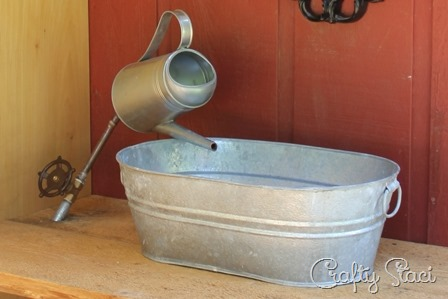 Galvanized tub sink and watering can faucet