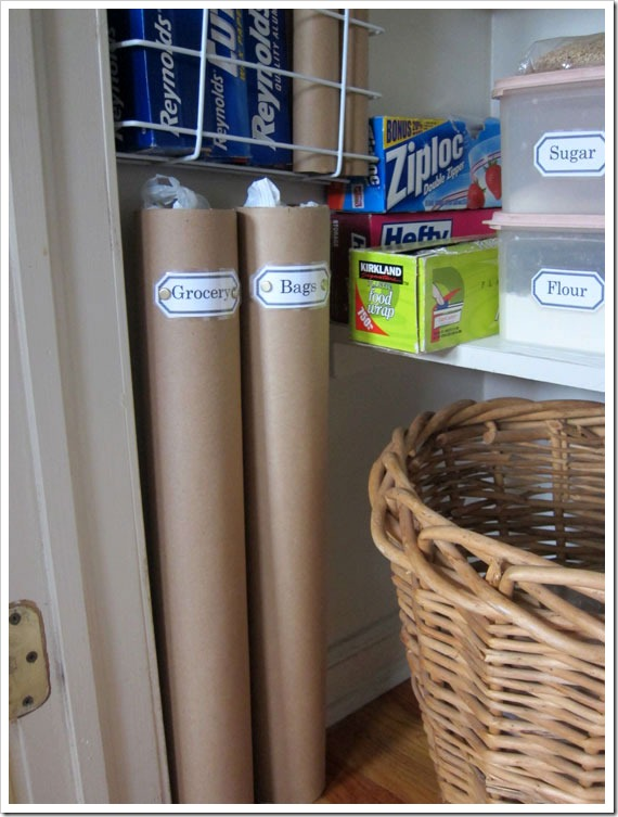 Use mailing tubes to store plastic grocery bags and paper towel tubes
