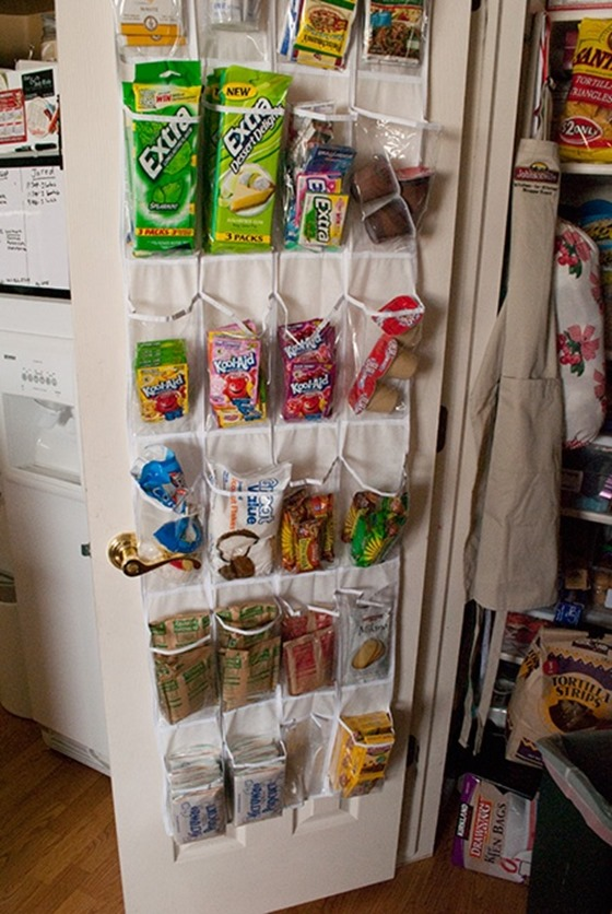 Use over-the-door shoe storage to organize snacks in pantry